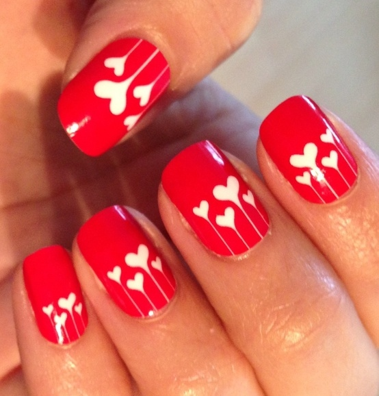 red nails with little hearts