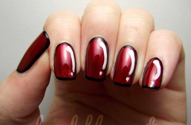 uñas rojas con negro y blanco
