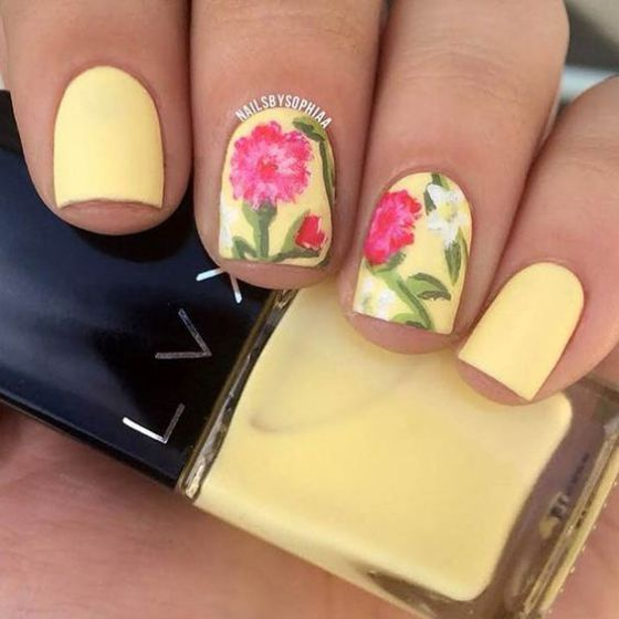 yellow nail art with flowers
