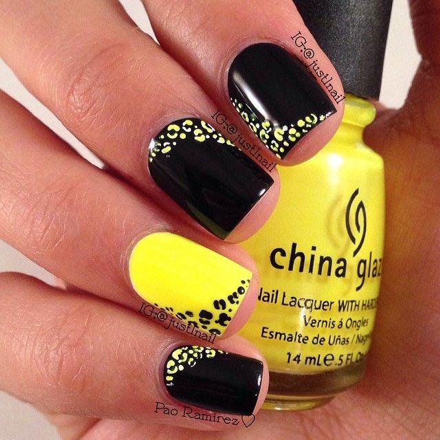 uñas de gel cortas amarillo y negro