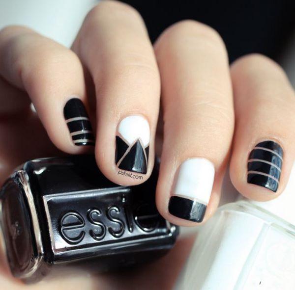 diseño de uñas blanco y negro con cintas