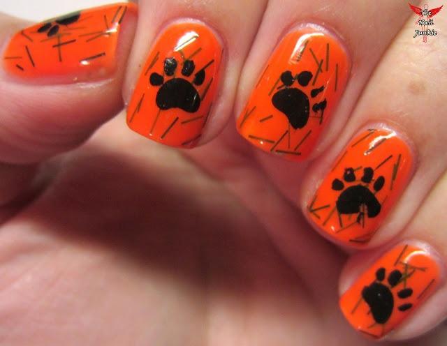patas de perros en uñas