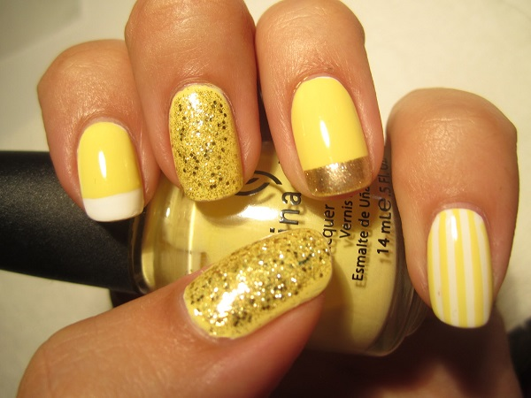 uñas decoradas de amarillo