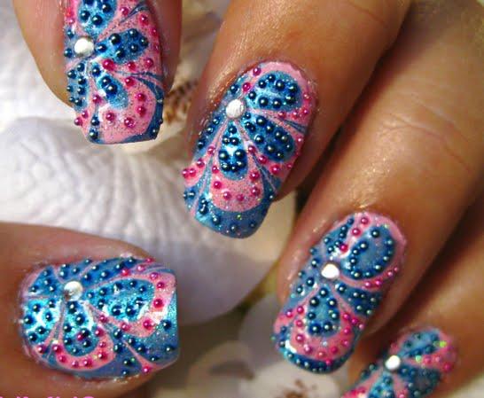 uñas decoradas en agua con accesorios