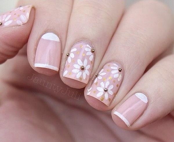 uñas decoradas rosadas con blanco y negro