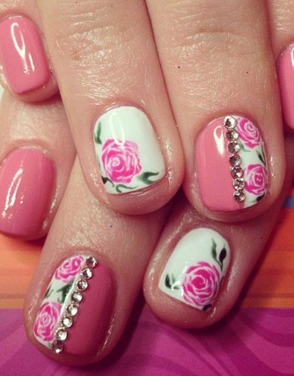uñas rosa y blanco con accesorios