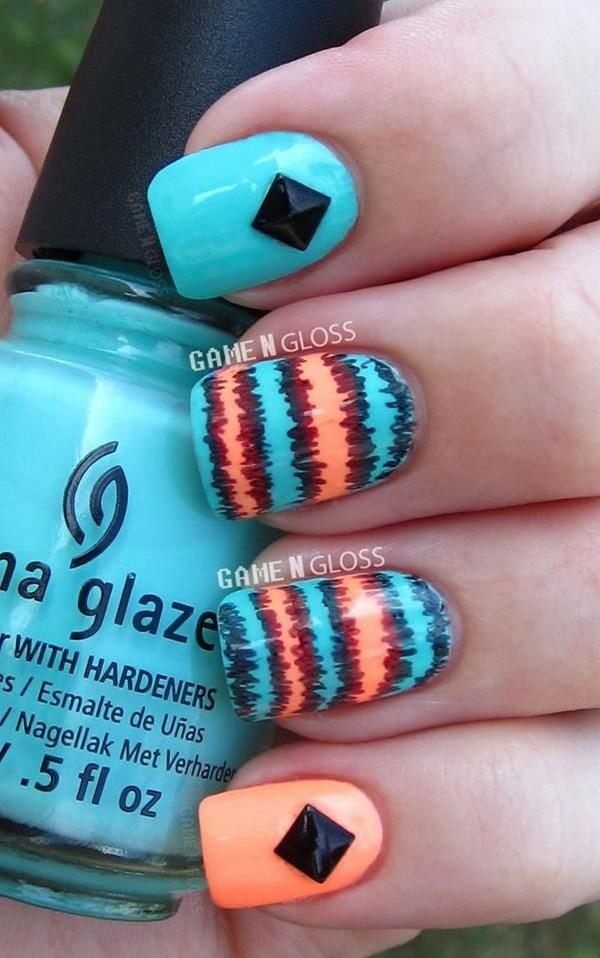 uñas azules con naranja